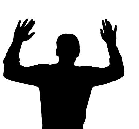 surrendering: Man surrendering with both hands raised in air