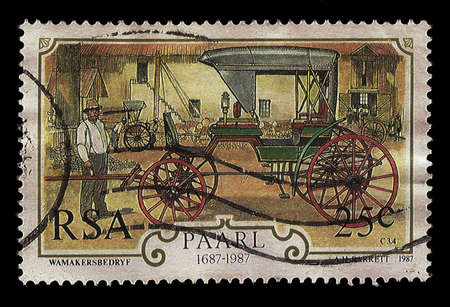 cutting horse: SOUTH AFRICA - CIRCA 1987  A stamp Printed in South Africa shows wagon maker with horse drawn carriage in factory, dedicated 300 anniversary of wagon maker industry 1687-1987, circa 1987