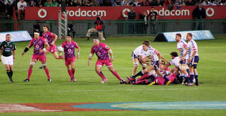 Rugby, Bulls Defensive Line-up; Spies; Steyn; Kruger, Bulls, in Pink jerseys in support of fighting cancer, Stormer scrumhalf Duvenage passing ball, Stormers v Bulls, Super Rugby, Loftus Versfeld, Pretoria , South Africa, 2 June 2012 Stock Photo - 14140950