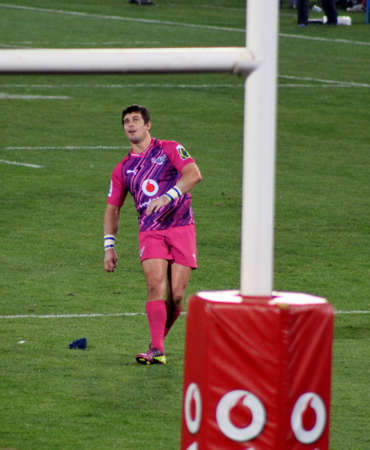 Rugby, Morne Steyn, Bulls, in Pink jerseys in support of fighting cancer, following flight of ball after kicking to poles after try scored, Stormers v Bulls, Super Rugby, Loftus Versfeld, Pretoria , South Africa, 2 June 2012 Stock Photo - 14140940