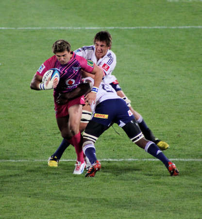 fighting cancer: Rugby,Wynand Olivier, Bulls, in Pink jerseys in support of fighting cancer, getting tackled, Stormers v Bulls, Super Rugby, Loftus Versfeld, Pretoria , South Africa, 2 June 2012