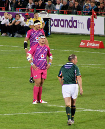 fighting cancer: Rugby, Pierre Spies, Bulls Captain, giving instructions, with Werner Kruger, Bulls, in foreground, in Pink jerseys in support of fighting cancer, Stormers v Bulls, Super Rugby, Loftus Versfeld, Pretoria , South Africa, 2 June 2012