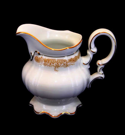 brim: Isolated Expensive Porcelain Teaset - Milk Jar with Golden Brim Stock Photo