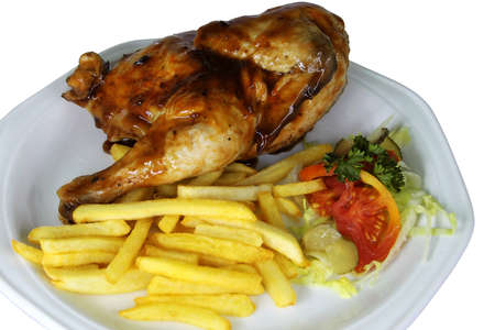 Isolated Half Chicken and Fries on White Plate Close Up photo