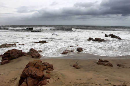 Picture of Beachfront in Stormy Weather with Sharp Rocks photo