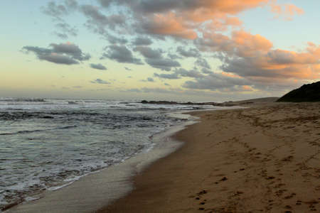 kwazulu natal: Picture of Seascape with Setting Sun on Clouds
