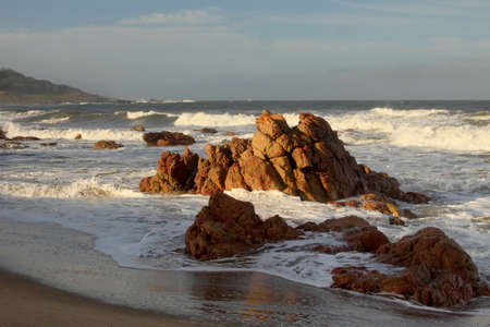 kwazulu natal: Picture of Seascape Sharps Rocks in Sea at Dusk