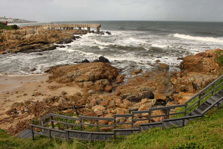 kwazulu natal: Picture of Curved Wooden Steps and Concrete Jetty in Storm over Sea Stock Photo