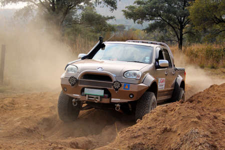 off course: BAFOKENG ? MAY 2013: Gold GWM Steed going through obstacle at new 4x4 track opening event May 18, 2013 at Bafokeng, Rustenburg, South Africa