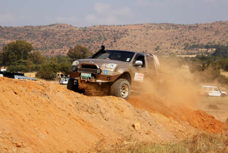 steed: BAFOKENG ? MAY 2013: Gold GWM Steed scaling steep sand hill obstacle at new 4x4 track opening event May 18, 2013 at Bafokeng, Rustenburg, South Africa   Editorial