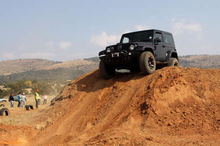 off course: BAFOKENG ? MAY 2013: Black Jeep Wrangler scaling steep sand hill obstacle at new 4x4 track opening event May 18, 2013 at Bafokeng, Rustenburg, South Africa