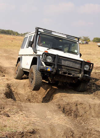 off course: BAFOKENG ? MAY 2013: White Mercedes-Benz G-Class scaling deep holes obstacles at new 4x4 track opening event May 18, 2013 at Bafokeng, Rustenburg, South Africa