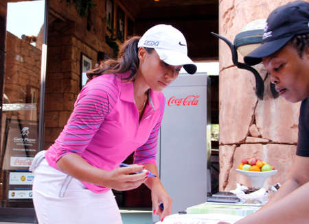 WOODS, CHEYENNE - NOVEMBER 17: Professional Golfer Playing at Gary Player Charity Invitational Golf Tournament signing in before tee-off November  17, 2013, Sun City, South Africa. Cheyenne Woods is a niece of Tiger Woods.
