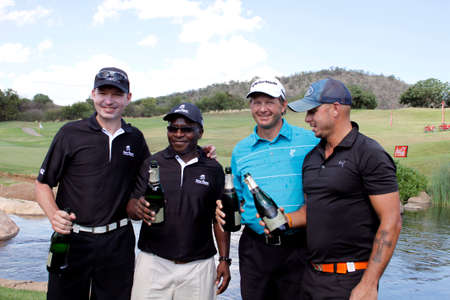 cricketer: TOURNAMENT WINNERS  - NOVEMBER 17: Gary Player Charity Invitational Golf Tournament  November  17, 2013, Sun City, South Africa. From left businessmen Anthony Leeming and Mike Dladla, former Proteas cricketer Herschelle Gibbs and double US Open champion R Editorial