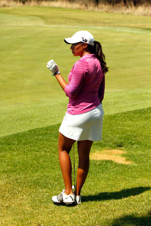 WOODS, CHEYENNE - NOVEMBER 17: Professional Golfer Playing at Gary Player Charity Invitational Golf Tournament waiting turn at green November  17, 2013, Sun City, South Africa. Cheyenne Woods is a niece of Tiger Woods.