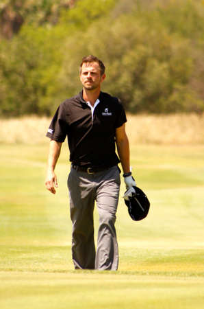 carmine: GIOVINAZZO , CARMINE  - NOVEMBER 17: Actor Guest Player Playing at Gary Player Charity Invitational Golf Tournament  November  17, 2013, Sun City, South Africa. Carmine walking down fairway.