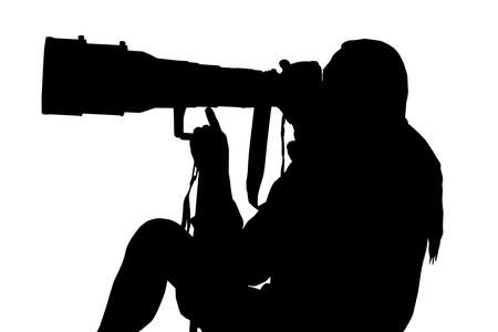 journalistic: Silhouette of Photographer Sitting with Large Lens on Monopod