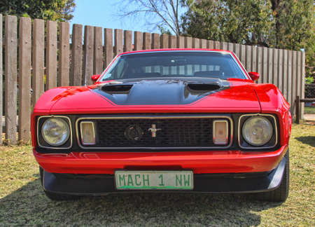 mach 1: RUSTENBURG, SOUTH AFRICA - SEPTEMBER 9  A bright red Ford Mustang Mach 1 front view on display at the half century celebration of the Rusoord old aged home on September 17, 2013 in Rustenburg South Africa