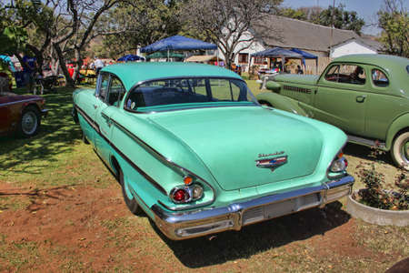 RUSTENBURG, SOUTH AFRICA - SEPTEMBER 9  A green 1958 Chevrolet Biscayne 4 Door rear view on display at the half century celebration of the Rusoord old aged home on September 17, 2013 in Rustenburg South Africa