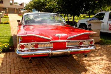 manufacturer: RUSTENBURG, SOUTH AFRICA – FEBRUARY 15:  Red 1960 Chevrolet Impala Bubble Top rear view in Private Collection Philip Classic Cars on February 15, 2014 in Rustenburg South Africa.