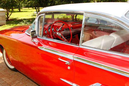 RUSTENBURG, SOUTH AFRICA – FEBRUARY 15:  Red 1960 Chevrolet Impala Bubble Top Side View in Private Collection Philip Classic Cars on February 15, 2014 in Rustenburg South Africa.