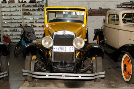 manufacturer: RUSTENBURG, SOUTH AFRICA – FEBRUARY 15   Yellow 1931 Chevrolet Coupe Front View in Private Collection Philip Classic Cars on February 15, 2014 in Rustenburg South Africa