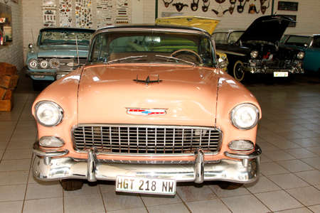 RUSTENBURG, SOUTH AFRICA – FEBRUARY 15:  Beige Orange 1955 Chevrolet Hard Top Coupe Front View in Private Collection Philip Classic Cars on February 15, 2014 in Rustenburg South Africa.