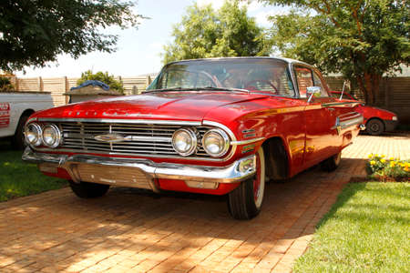 RUSTENBURG, SOUTH AFRICA – FEBRUARY 15:  Red 1960 Chevrolet Impala Bubble Top front view in Private Collection Philip Classic Cars on February 15, 2014 in Rustenburg South Africa.