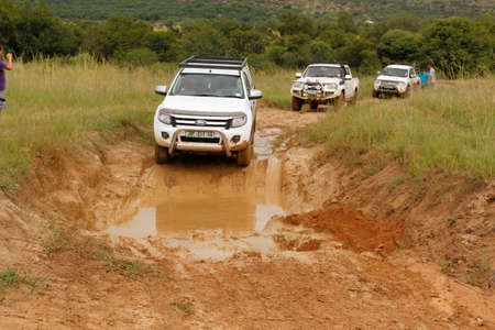 rustenburg: BAFOKENG - MARCH 8: White Ford Ranger XLS with Silver Canopy crossing water obstacle at Leroleng 4x4 track on March 8, 2014 in Bafokeng, Rustenburg, South Africa