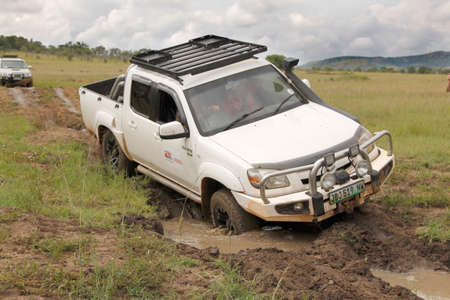 rustenburg: BAFOKENG - MARCH 8: White Mazda BT-50 4x4 3L crossing water obstacle at Leroleng 4x4 track on March 8, 2014 in Bafokeng, Rustenburg, South Africa