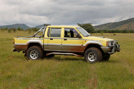 rustenburg: BAFOKENG - MARCH 8: Yellow Mitsubishi Colt Rodeo Twin Cab at Leroleng 4x4 track on March 8, 2014 in Bafokeng, Rustenburg, South Africa Editorial