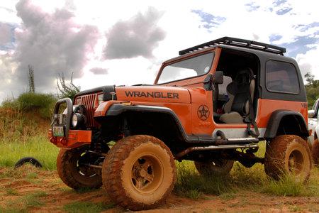 rustenburg: BAFOKENG - MARCH 8: Crush Beige Jeep Wrangler Off-Roader V8 at Leroleng 4x4 track on March 8, 2014 in Bafokeng, Rustenburg, South Africa
