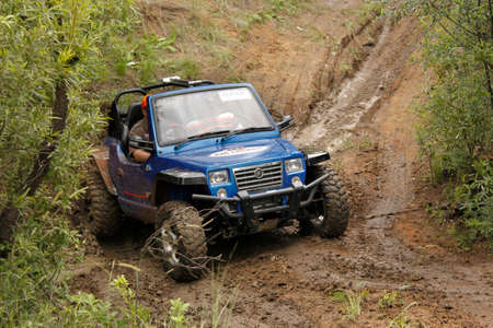 rustenburg: BAFOKENG - MARCH 8: Blue GSMoon 2 Seater Quad Bike crossing obstacle at Leroleng 4x4 track on March 8, 2014 in Bafokeng, Rustenburg, South Africa