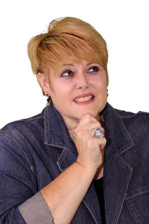 'body language': Mature Woman Body Language Expressions - Looking up unsure Stock Photo