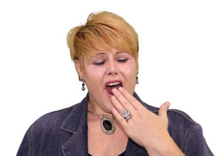 'body language': Mature Woman Body Language Expressions - Bored Open Mouth Yawning Stock Photo