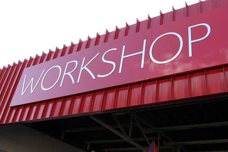 demarcation: Picture of a rooftop Workshop Text Sign Stock Photo
