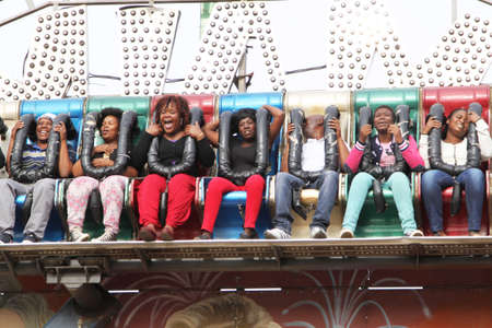 rise fall: RUSTENBURG, SOUTH AFRICA - MAY 25: Black African people enjoying rise and fall electronic ride at Rustenburg Fair on May 25, 2014 in Rustenburg South Africa. Editorial