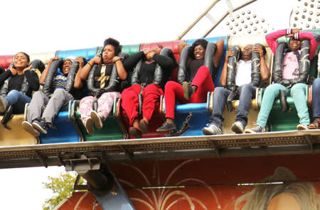 rustenburg: RUSTENBURG, SOUTH AFRICA - MAY 25: Black African people enjoying rise and fall electronic ride at Rustenburg Fair on May 25, 2014 in Rustenburg South Africa. Editorial
