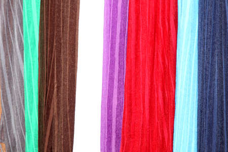 providing: Variety of Hanging Scarves Providing Colourful Backdrop for Graphic Artists Stock Photo