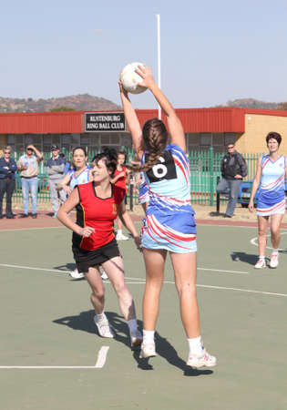 rustenburg: RUSTENBURG, SOUTH AFRICA - June 6:  Korfball League games played at Olympia Park on June 6, 2015 in Rustenburg South Africa.  Ladies team:  Girl catching ball. Editorial