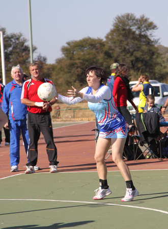 rustenburg: RUSTENBURG, SOUTH AFRICA - June 6:  Korfball League games played at Olympia Park on June 6, 2015 in Rustenburg South Africa.  Ladies team:  Girl trowing ball at goal. Editorial