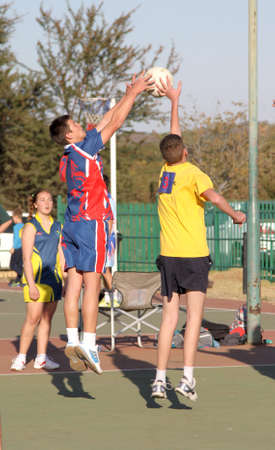 rustenburg: RUSTENBURG, SOUTH AFRICA - June 6:  Korfball League games played at Olympia Park on June 6, 2015 in Rustenburg South Africa.  Mens team:  Men competing for ball.