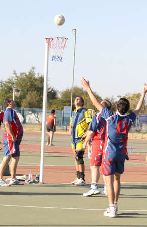 rustenburg: RUSTENBURG, SOUTH AFRICA - June 6:  Korfball League games played at Olympia Park on June 6, 2015 in Rustenburg South Africa.  Mens team:  Man attempting goal throw at net. Editorial