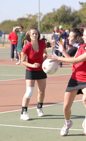 rustenburg: RUSTENBURG, SOUTH AFRICA - June 6:  Korfball League games played at Olympia Park on June 6, 2015 in Rustenburg South Africa.  Ladies team:  Girls competing for ball. Editorial