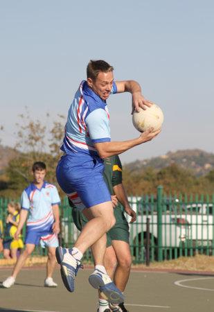 rustenburg: RUSTENBURG, SOUTH AFRICA - June 6:  Korfball League games played at Olympia Park on June 6, 2015 in Rustenburg South Africa.  Mens team:  Man catching ball. Editorial