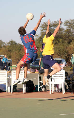 rustenburg: RUSTENBURG, SOUTH AFRICA - June 6:  Korfball League games played at Olympia Park on June 6, 2015 in Rustenburg South Africa.  Mens team:  Man competing for ball in air. Editorial
