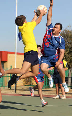 blocking: RUSTENBURG, SOUTH AFRICA - June 6:  Korfball League games played at Olympia Park on June 6, 2015 in Rustenburg South Africa.  Mens team:  Man blocking throw.