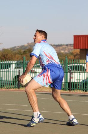 rustenburg: RUSTENBURG, SOUTH AFRICA - June 6:  Korfball League games played at Olympia Park on June 6, 2015 in Rustenburg South Africa.  Mens team:  Man ready to throw ball.