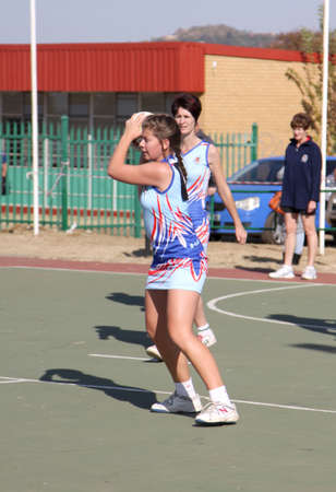 rustenburg: RUSTENBURG, SOUTH AFRICA - June 6:  Korfball League games played at Olympia Park on June 6, 2015 in Rustenburg South Africa.  Ladies team:  Girl trowing ball.