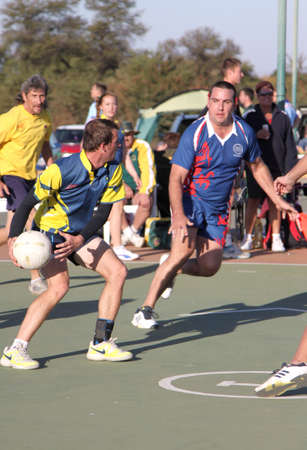 rustenburg: RUSTENBURG, SOUTH AFRICA - June 6:  Korfball League games played at Olympia Park on June 6, 2015 in Rustenburg South Africa.  Mens team:  Man throwing ball.